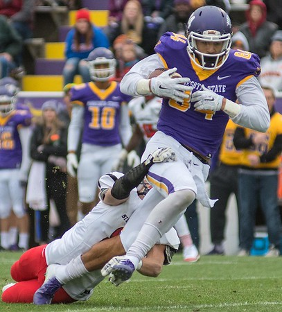 Minnesota State's Shane Zylstra turns upfield after making a catch while St. Cloud State's Ben Gutschow tries to tackle him. The Mavericks won 45-10 at Blakeslee Stadium on Saturday. Photo by Jackson Forderer