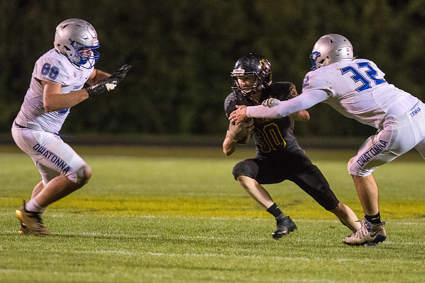Owatonna's Joshua O'Daffer (88) and Isaac Gefre (32) close in on Mankato East's Grant Hermer during Friday's game played at East. The Owatonna defense left little room for the Cougars to run their offense. Photo by Jackson Forderer