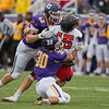 Minnesota State's Cade Johnson (30) and Jordan Bergen (42) converge on St. Cloud State's quarterback Justin Czech, causing a fumble in the third quarter that was returned for a touchdown by MSU's Jayme Laplant. The Mavericks defense shined in their 45-10 homecoming victory. Photo by Jackson Forderer