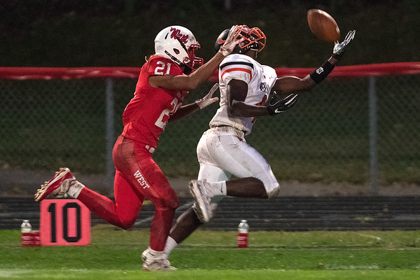 Winona's Terrell Hall tries to make a one-handed catch while being defended by Melik Davis of Mankato West during Friday's game played in Mankato. Hall was unable to come up with the grab but would later catch a pass to put the Winhawks in scoring position. Photo by Jackson Forderer