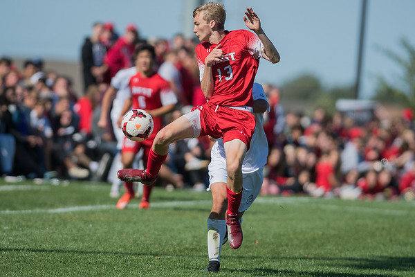 Mankato West's Jack Raverty clears the ball out of harms way as Mankato East pressed against the West defense in Saturday's boys soccer game. Photo by Jackson Forderer