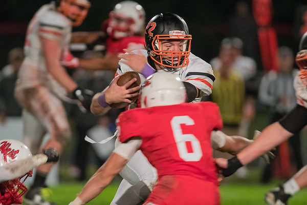 Winona's Trevor Pomeroy carries the ball through Mankato West's defense while attempting to avoid a tackle from Wyatt Block (6) in the third quarter of Friday's Big Nine game played in Mankato. Photo by Jackson Forderer