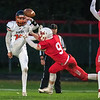 Mankato West's Clay Herding (9) blocks a punt attempt by Winona's Jackson Nibbelink in the first half of Friday's Big Nine game. West would score on the ensuing possession but lost the game to the Winhawks. Photo by Jackson Forderer