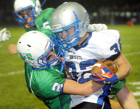 Maple River's Nick Steinhaus (2) collides with Lake Crystal Wellcome Memorial running back Matt Sheetz (32) during the first half Friday in Mapleton. Photo by Pat Christman