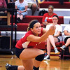 Mankato West's Jessica Goerger lunges for the ball during West's first game against Owatonna Tuesday at the West gym.