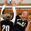 Mankato East's Faith Depuydt (41) and Jackson County Central's Michelle Van Epps work to tip the ball across the net during their first game Tuesday at the East gym.