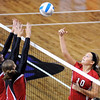 Mankato West's Jessica Goerger tries to tip the ball over a pair of St. Clair defenders during their match at the Southern Minnesota Volleyball Invitational Saturday at Bresnan Arena.