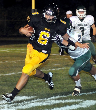 Mankato East's Brandon Adema is chased down by Faribault's Connor Wierschem during the second half Friday at Wolverton Field.