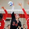 Bethany Lutheran College's Shelby Wiederhoeft hits the ball between a pair of St. Mary's defenders during their match Saturday in the Bethany Lutheran Invitational.