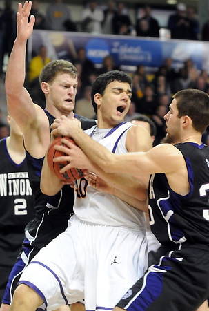 Minnesota State's Assem Marei is surrounded by Winona State's Clayton Vette (left) and Taylor Cameron during the second half of their NCAA Division II Central Region championship game Tuesday at Bresnan Arena.