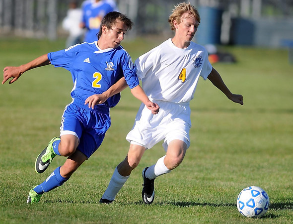 Pat Christman<br /> Waseca's Hugo Castaneda (2) and Mankato Loyola's Quin Seys (4) chase down the ball during the first half Thursday at the Good Counsel field.
