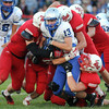 Pat Christman<br /> The Mankato West defense wraps up Owatonna running back Aaron Peterson during the first half Friday at Todnem Field.