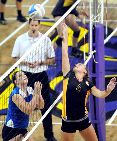 Pat Christman<br /> Mankato Loyola's Alli Menke watches as Mankato East's Kassie Breitkreutz tips the ball over the net during their game in the Manakto West volleyball tournament Saturday at Bresnan Arena.