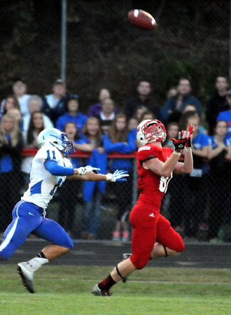 Pat Christman<br /> Mankato West's Will Claussen outruns Owatonna's Sam Fenske to catch a 51-yard touchdown pass during the first half Friday at Todnem Field.