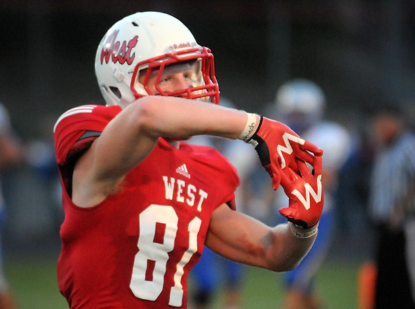 Pat Christman<br /> Mankato West's Will Claussen celebrates a first half touchdown against Owatonna Friday.