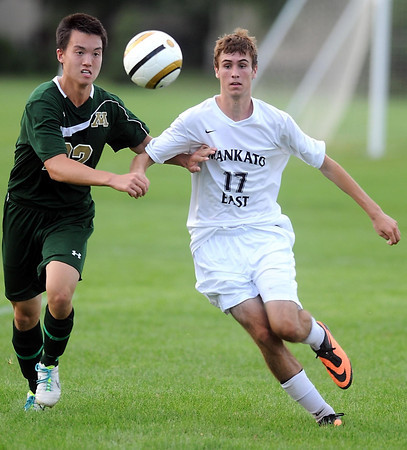 Pat Christman<br /> Rochester Mayo's Michael Poeschla, left, and Manakto East's Brandon Sloniker chase down a ball during the second half Tuesday.