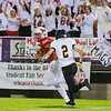 Dondre Spann of Mankato West turns upheld after making a catch and is pursued by Mankato East's Issiah Wilke during last Friday's game played at Blakeslee Stadium. Photo by Jackson Forderer