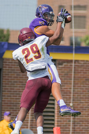 Shane Zylstra of Minnesota State hangs onto a catch in the end zone while being defended by University of Minnesota  Crookston's Anfernee Cooper (29) during Saturday's game. The MSU offense racked up 616 total yards against Crookston. Photo by Jackson Forderer