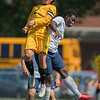 Mankato East's Colin Knutson (left) and St. Peter's Zephaniah Kyoore (right) collide while jumping for a header during Saturday's soccer match. The game ended in a 1-1 draw. Photo by Jackson Forderer