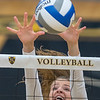 Gustavus' Dam Haugen goes up for a block against a Hamline player's spike during Wednesday's match. The Gusties won the match 3-0. Photo by Jackson Forderer