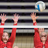 Jenna Courier (left) and Mattea Burmeister of Mankato West go up for a block against a Mayer Lutheran spike in the championship game of the West Volleyball Invitational played on Saturday at Bresnan Arena. The Scarlets lost the game to Mayer Lutheran but took second place in the tournament. Photo by Jackson Forderer