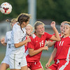 Katie Roberts (15) of Mankato West flicks the ball with a header past Rochester Century's Nicole Powell in the first half of Tuesday's game. Roberts later would score the Scarlets' second  goal to help the team win 3-0. Photo by Jackson Forderer