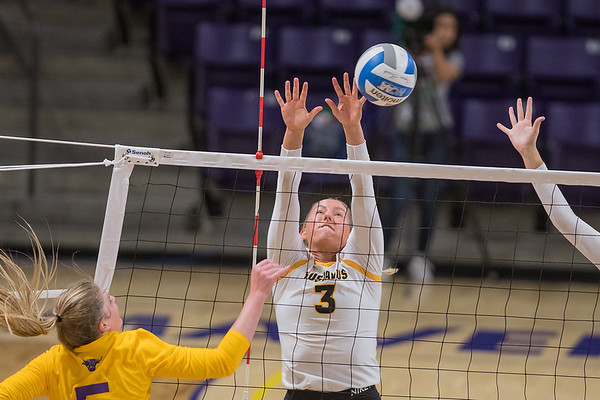 Gustavus' Nora Holtan goes up for a block adjacent Minnesota State's Alivia Garbe. Photo by Jackson Forderer