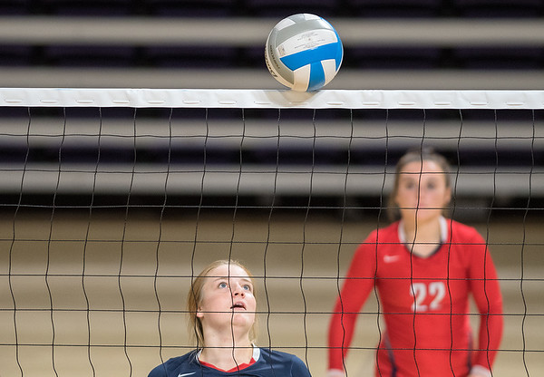 Sarah Conlon of St. Peter watches the ball balance on top of the net for a split-second as the Saints played Sibley East in the third-place match of the Manakto West Volleyball Invitational. St. Peter took third in the tournament. Photo by Jackson Forderer