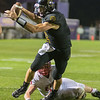 Mankato East's Riley Gruenes breaks a tackle attempt by Lucas Warner of Mankato West on his way to the end zone for Mankato East's second touchdown of the game. Photo by Jackson Forderer