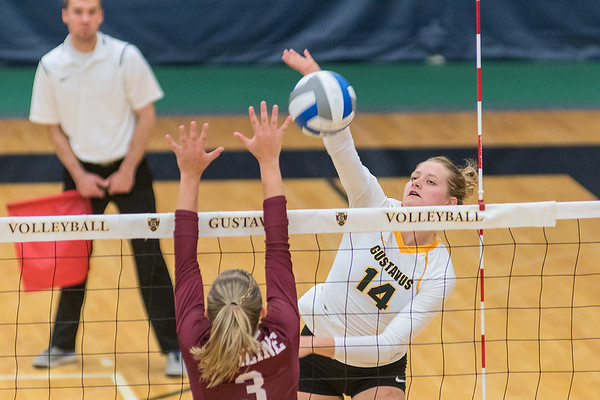 Hanna Albers (14) of Gustavus hits a spike against a block attempt by Hamline's Stephanie Maresh in the second game of Wednesday's volleyball match. The Gusties took the match in three straight games to improve to 8-1. Photo by Jackson Forderer