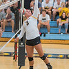 Nora Holtan of Gustavus tips a ball over the net during the match against Hamline on Wednesday. Holtan is a senior setter on the Gusties team. Photo by Jackson Forderer