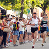 Lee Troop, 37, of Boulder, at left, followed by Adam Rich speeds towards the finish line at the West End 3K race on Pearl Street on Thursday, July 22, 2010, in downtown Boulder. Troop won the men's elite race.<br /> Jeremy Papasso/ Camera
