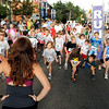 The kids stretch out before their run at the West End 3K race on Pearl Street on Thursday, July 22, 2010, in downtown Boulder.<br /> Jeremy Papasso/ Camera