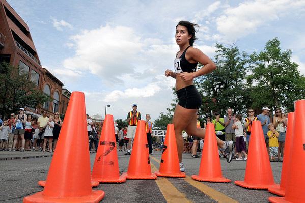 Kellie Maestrey, 21, of Beachwood, N.J., rounds the cones after her first lap at the West End 3K race on Pearl Street on Thursday, July 22, 2010, in downtown Boulder. <br /> Jeremy Papasso/ Camera