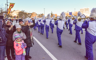 Family Members cheer on students of the West Orange High School Marching Band as they perform in the 98th Annual Thanksgiving Day Parade. 11/23/17 Credit Thomas Lightbody