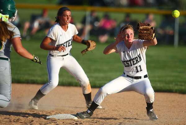 5-30-14<br /> Western Sectional softball<br /> Western's Brook Strunk tries to catch the ball before Benton Central's runner makes it to second.<br /> Kelly Lafferty | Kokomo Tribune