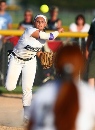 5-30-14<br /> Western Sectional softball<br /> Western's Shelby Gilbert throws the ball to first.<br /> Kelly Lafferty   Kokomo Tribune