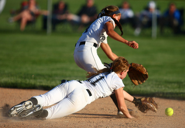 5-30-14<br /> Western Sectional softball<br /> Western's Evie Glover and Brook Strunk lunge for the ball.<br /> Kelly Lafferty   Kokomo Tribune
