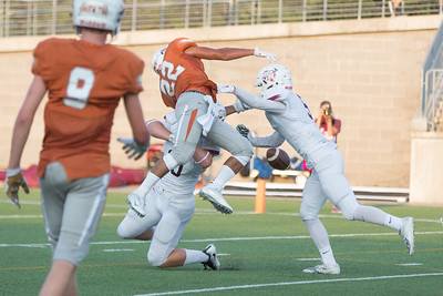 Westwood Senior Prince Ugwu is blocked by Rouse players Friday at  Kelly Reeves Athletic Complex.
