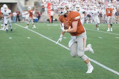 Westwood Senior Colin Iguchi carries the ball against Rouse Friday at  Kelly Reeves Athletic Complex.