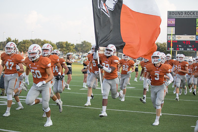 Westwood players run on the field before the game against Rouse on Friday at  Kelly Reeves Athletic Complex.