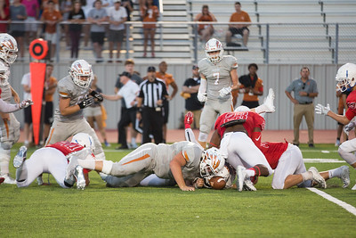 Westwood and Leander players dive on a loose ball Friday at Bible Stadium.