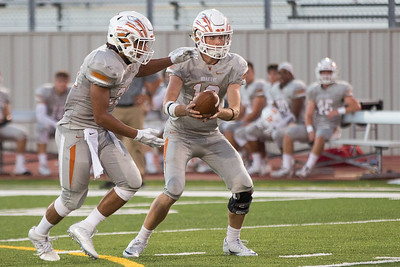 Westwood Junior Will Jennings passes the ball off to Senior Prince Ugwu against Leander Friday at Bible Stadium.