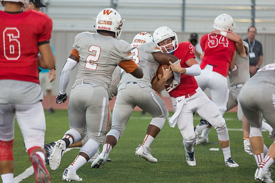 Westwood senior Miles Webber sacks Leander senior Kyle Irlbeck Friday at Bible Stadium.