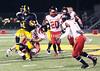1 Devonte Battles gets tackled by the team 26Jonah Harrison 13 Tyler Moss