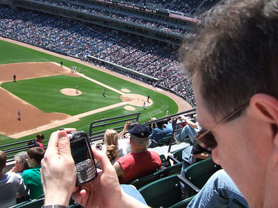 Barry watches the Sox game on his mobile sling player while at the sox game.