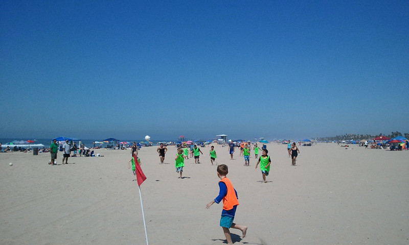 Beach soccer game.