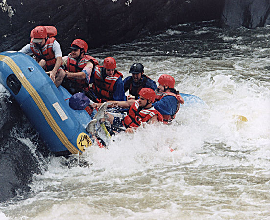 "Pillow Rock and Roll Over - October, 1999 <br /> Pillow Rock Rapids, Gauley River, Fayetteville, West Virgina<br /> Just a great picture - the only part of me that's above the water is my shoes.<br /> We always agree to take the best (fastest and toughest) lines; for this one you haul ass across the river and bank off the ""pillow"" rock on the opposite side. Unfortunately I am sitting exactly in the wrong  position (front-left is my favorite) for this maneuver. The picture was taken at the perfect moment: I am just about completely underwater, all that's left is my shoes on the edge of the boat."