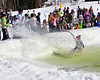 "A snowboarder soaked the crowd at Wildcat Mountain Ski Area, during their annual ""Wet Ditch Skim Contest, on Saturday, April 3rd, 2010. Skiers & riders attempted to carry as much speed as possible to skim across a water-filled ditch, at the base of the Pinkham Notch ski area, in Jackson, NH."