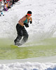 "Cristy Lester, 21, of Outer Banks, North Carolina, tries to make it across a pond riding her snowboard, during the annual ""Wet Ditch Skim Contest, held at Wildcat Mountain Ski Area, on Saturday, April 3rd, 2010. Skiers & riders attempted to carry as much speed as possible to skim across a water-filled ditch, at the base of the Pinkham Notch ski area, in Jackson, NH."